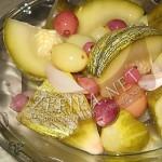 Маринованные огурцы с кабачками и виноградом