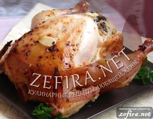 Рецепт курицы, фаршированной рисом с орехами и сухофруктами.