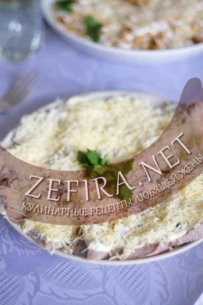 Закуска из языка с сыром и изюмом (фото)